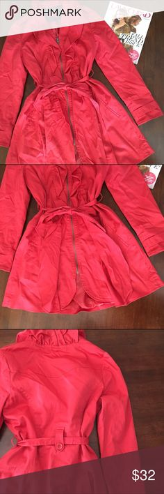 🎀PRICE DROP🎀 Elle Red Trench Coat Tie around waist with belt loops. Faux front pockets. Zip to close. Cuffed sleeves. Pleaded in front ant back. Small stain in right back sleeve (see last pic), verrrry tiny!  Sleeve: 24' long from seam. Length: 33'. Bust:36'. Elle Jackets & Coats Trench Coats