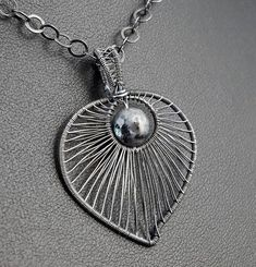 Sterling Silver pendant with Larvikite / wire wrapped / #SterlingSilverWire