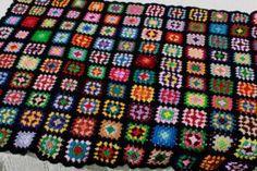retro crochet granny square afghan blanket, kaleidoscope of colors on black