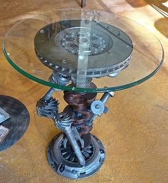 Engine parts make wonderful, sculptural table bases with little else needed, just a glass tabletop. Shared by www.highroadorganizers.com