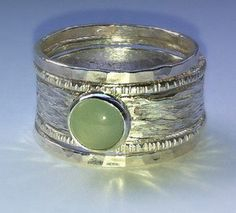 Unique Aquamarine rustic recycled sterling silver stackable wedding or engagement bands. A one of a kind rustic wedding and engagement ring set, handmade of recycled silver and embossed with a rippled texture, featuring a 6 mm smooth natural Aquamarine cabochon.