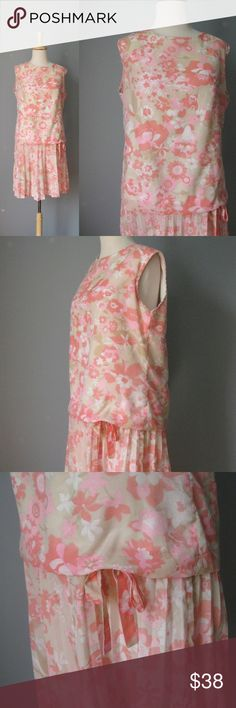 """Vintage 1960s Floral Dress Peach Garden Party Pretty, summery dress from the 60s Made by the Carol Brent Co for Montgomery Ward Pale ecru background w peachy floral print Sleeveless, dropped waist, blouson bodice, pleated skirt The whole effect is very young, easy and feminine.  Fully lined in cotton Outer shell : 40% Polyester, 20% cotton, 40% nylon Metal zipper Flat measurements, pls double where appropriate: armpit to armpit: 20"""" waist: 18 3/4"""" hip: 21"""" length: 36 1/4""""   thanks for…"""