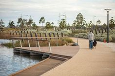 The wetland areas and parks feature walking paths and timber platforms leading to the water's edge.: