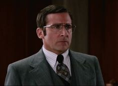 Brick Tamland (Steve Carell) smiles during a scene from the 2013 film Anchorman 2: The Legend Continues.