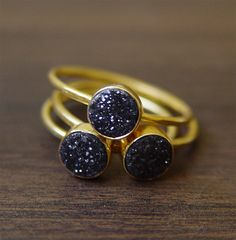 Hey, I found this really awesome Etsy listing at http://www.etsy.com/listing/150506176/black-druzy-ring-in-14k-gold