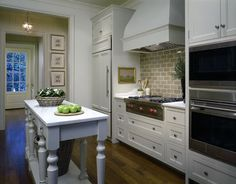 Kitchen Portfolio - Revival Construction.  I would like to do a built-in fridge like this.  Love the hall light.