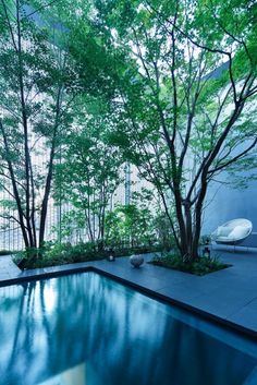 Optical Glass House by Hiroshi Nakamura & NAP A tree-filled courtyard is glimpsed through the shimmering glass-brick facade of this house in Hiroshima, designed by Japanese architect Hiroshi Nakamura. Design Patio, Exterior Design, Garden Design, House Design, Loft Design, Design Design, A As Architecture, Japanese Architecture, Sustainable Architecture