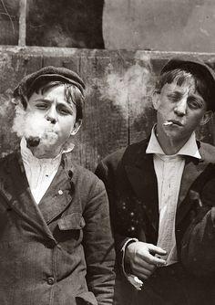 Young newsies smoke, 1930s.