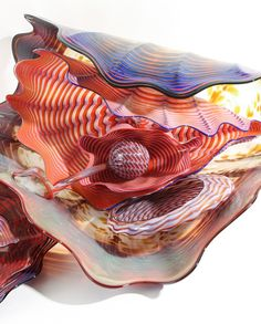 "Chihuly, Dale (American, born 1941), Pozzuoli Earth Persian Set, 1989, (9 pc.s) (Chihuly Inventory No. #551.89.1), 9 pieces the largest being 29.25 x 23 x 12 inches, there are 5 shell forms, 2 flat panel forms with undulating edges, I ""rattle like form"" and a ""pistil like"" form sitting inside of a shell, signed and dated on the top of the pistil like form."