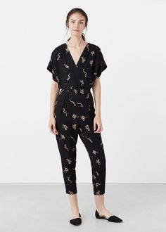 Printed wrap jumpsuit REF. 73060271 - SNAKE $59.99 Color: black Cropped design Flowy fabric Printed design Wrap neckline Short rolled-up sleeve Adjustable elastic waist · Inside leg measurement 25.0 in · Side length 44.09 in · Back length 15.35 in