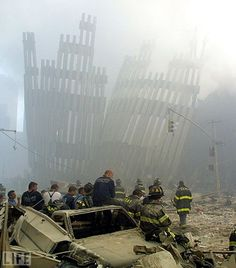Firefighters take a break at the remains of the twin towers of the World Trade Center in lower Manhattan 11 September, 2001 World Trade Center, Trade Centre, 11 September 2001, Remembering September 11th, We Will Never Forget, Lest We Forget, Sad Day, God Bless America, World History
