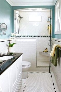 Avoid bouts of claustrophobia by giving a shower an airy appeal. Here, a wainscot tile job continues to the shower and stops short to squeeze in a glass shower door. The glass enclosure allows for more admiration for a band of mosaic tile work. Photo: J Bad Inspiration, Bathroom Inspiration, Shower Remodel, Bath Remodel, Ideas Baños, Decor Ideas, Tile Ideas, Decorating Ideas, Bathroom Renos