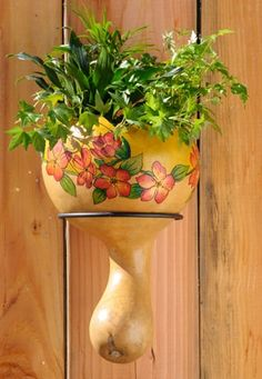 Showcase your gourd art and finish it off with a flower arrangement to add fresh new twist to the traditional plastic handing flower pots.