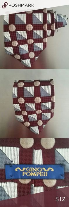 Gino Pompeii Burgundy Polka Dot Tie Gino Pompeii Burgundy Polka Dot Tie. Made with 100% silk. Accessories Ties