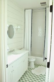 "Guest bath.  Tub shower combo with subway ""panels""? Tall curtain split with liner for shower.  Ship lap on mirror wall"