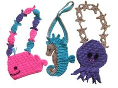 Your little girl will absolutely love these little purses!!!! There is a friendly octopus with such a sweet little smile and starfish joined together for a handle. The seahorse looks like he's just bopping along looking for some friends. He is a narrow purse so he would be great for pens or pencils and even a tube of lipgloss will fit into his head!!! The whale purse has tropical fish joined together