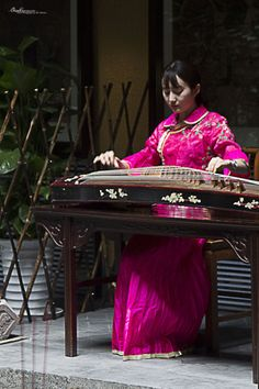 Chinese traditional instrument, Chengdu, China. Try tea houses and discover the local monasteries of Chengdu, Sichuan, China for a taste of oldworld China.