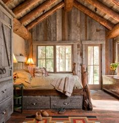 Log cabin, bedroom. beautiful high ceilings, rustic interior.