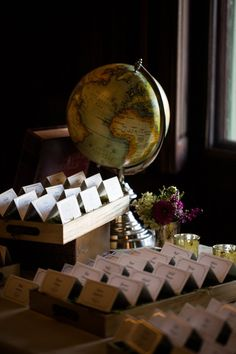 escort cards on gold trays and beds of moss / travel theme/ globe/ adventurers Photo: The Happy Couple Planning: Atrendy Wedding Flowers: Uncloudy Studio