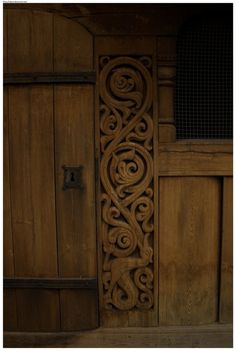 Carving around Heddal stave church door, identical to that at cliving. Viking Designs, Long House, Viking Art, Garden Doors, Anglo Saxon, Wood Paneling, Runes, Vikings, Tall Cabinet Storage