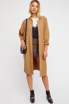Lia Trench | Lightweight and slouchy cotton trench coat featured in an oversized silhouette.  * Front slip and hip pockets * Button closure * Slit in back