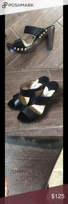 Jimmy Choo Ulrika Clogs Black snake embossed Jimmy Choo clog sandals. No box or dust covers. In excellent condition. Size 38 but fits like a 7.5 Jimmy Choo Shoes Mules & Clogs