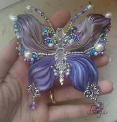 Bead embroidery and shibori silk butterfly by Reje, handmade in Italy…