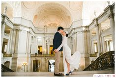 Kissing in the rotunda of San Francisco City Hall. Documentary Wedding Photographer - Hazel Photo Weddings