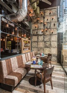 Unique light fittings featuring decorative bare lamps for Thaikhun - a new casual dining chain by Thai Leisure Group Interior design: JMDA