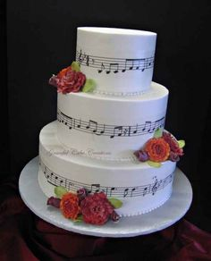 THIS WAS MY WEDDING CAKE by Graceful Cake Creations...that's my hubby's song wrapped around the cake! (music is recorded and my husband owns the rights)