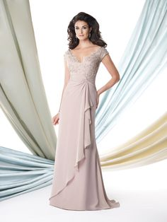 Chiffon mock-wrap A-line dress with lace cap sleeves, scalloped front and back V-necklines, hand-beaded lace bodice, ruched chiffon empire waistline with knot detail and cascading side ruffle spilling into draped overskirt, sweep train, suitable as a mother of the bride dress or a formal gown. Matching shawl included.Sizes: 4 – 20, 16W – 26W