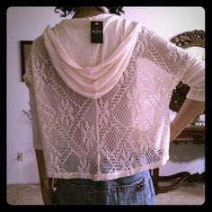 NWT Hollister ivory hoodie size small NWT is this super chic short hoodie by Hollister. Ivory color. Crochet back . Thin material . Hollister Sweaters
