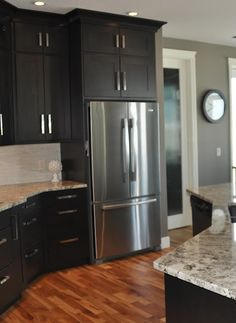 Dark cabinets with gray walls...