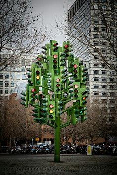 """""""Traffic Light Tree"""" by Pierre Vivant. East London on a roundabout just beyond Canary Wharf estate.awesome street art installation from a real piece of infrastructure , make them everywhere , it would be like christmas if you added baubles and tinsel too Land Art, Art Conceptual, Street Art, Instalation Art, Urbane Kunst, Wow Art, Traffic Light, Arte Pop, Tree Lighting"""