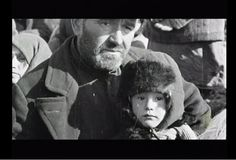A Russian Jewish boy waiting his turn to die along with father