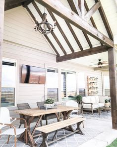 Holly from never ceases to amaze us with her beautiful designs! The dark wood beams and white ceiling is the perfect touch to this back patio. Plus, check out the chandelier and ceiling fan combo- 😍 LOVE the Coral Bay in this space. Farmhouse Style Decorating, Farmhouse Decor, Modern Farmhouse, Patio Fan, Ceiling Fan Chandelier, Diy Patio, Patio Ideas, Backyard Patio, Backyard Ideas
