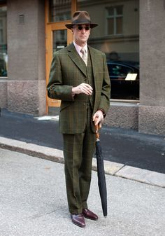"""Janne, 51  """"I'm wearing an English tweed suit tailor-made in London. I live in Mexico, where I normally wear a white linen suit.The 20s and the 30s inspire my style. Noël Coward had a great style.""""    Fantástico."""