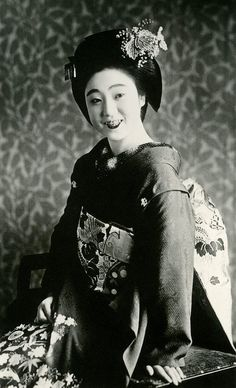 "Maiko Mamewaka appears in the 1939 ""Kamogawa Odori"" (Kamo River Dance), the spring and autumn dances of the Ponto-cho hanamachi (geisha district) in Kyoto. Here she is wearing an unusual Kiri (Paulownia) kanzashi (hair ornament) and a Takara Zukushi (Treasure Symbols) kimono. Japan..."