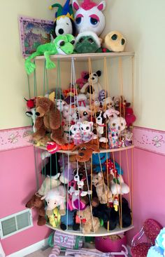 My husband's solution to my daughter's stuffed animal obsession. Animal Zoo! Love the rounded corner shelves and the storage above and below.