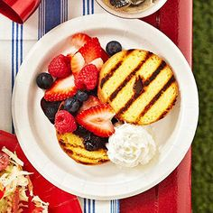 Grilled doughnuts topped with seasonal berries and whipped topping make for a deliciously easy of July treat. If there's a grill at your picnic site, use it to heat up your doughnuts -- if not, the dessert will still be tasty without the grill marks! Patriotic Desserts, Blue Desserts, 4th Of July Desserts, Healthy Desserts, Donut Recipes, Fruit Recipes, Dessert Recipes, Picnic Recipes, Bhg Recipes