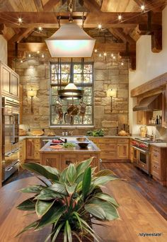 """Ok well this kitchen is stunning. Probably not what we're looking for but I love the wooden beam over oven hood, pot holder over island, and the extra lighting that makes an """"X"""""""