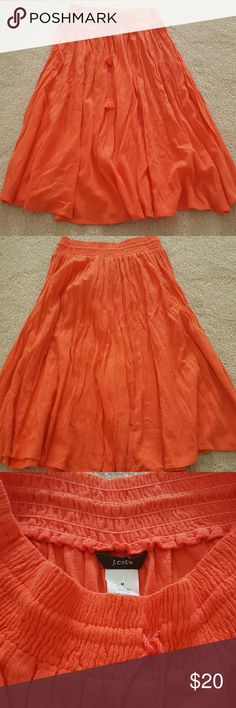 J. Crew Skirt The skirt is a light flowy 100% cotton elastic waste with feinged draw string to tighten. The skirt is in mint condition. J. Crew Skirts Midi