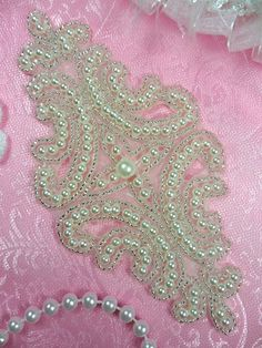Designer Pearl Silver Beaded Applique    All measurements are approximate. 6 x 2.75    Made with Silver beads and White Pearls Absolutely stunning
