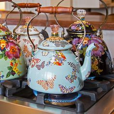 Butterfly Garden Sky Tea Kettle: The breathtaking butterflies on our fresh sky-blue hue are doubly enchanting when mixed on the table with the original white Butterfly Garden Enamelware Collection. Each hand-applied butterfly on the Sky Butterfly Garden Tea Kettle shows off a favorite MacKenzie-Childs pattern.
