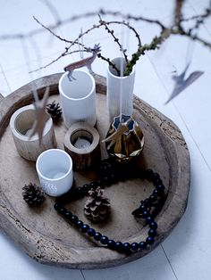 natural wood tray, mixed texture votives and a vase of branches with ornaments; simple, rustic & chic.