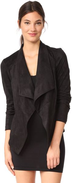 This luxurious, faux-suede BB Dakota jacket has draped lapels framing the open placket. Knit insets relax the long sleeves. On-seam hip pockets. Unlined. Fabric: Faux suede. Shell: 90% polyester/10% spandex. Trim: 100% polyester. Hand wash or dry clean. Imported, China. Measurements Length: 23.5in / 60cm, from shoulder Measurements from size S