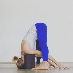 restorative yoga pose with bolster  supported inversion