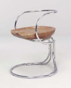 VLADIMIR TATLIN   860 CHAIR   after the original design of 1927, manufactured c.1970-80 by Gordon International, chromed steel, leather  30½in. (78cm.) height