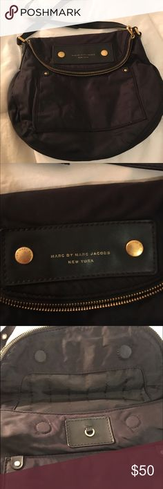 Marc Jacobs Black Crossbody Marc Jacobs Black Crossbody. Canvas material. In good condition but has some small imperfections if you look closely. Has a large zippered pocket on flap and a small zippered pocket inside flap. Has 2 cell phone sized pockets inside. Make an offer. Marc by Marc Jacobs Bags Crossbody Bags