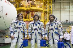JSC2016e026342 (03/04/2016) --- In the Integration Facility at the Baikonur Cosmodrome in Kazakhstan, Expedition 47-48 crew members NASA Astronaut Jeff Williams (left) and Alexey Ovchinin (center) and Oleg Skripochka (right) of Roscosmos pose for pictures March 4 in front of the scaffolding surrounding their Soyuz TMA-20M spacecraft during final pre-launch training. The trio will launch March 19, Kazakh time, for a six-month mission on the International Space Station.